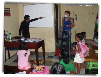 My Aunt Fiona at the Boomerang School with her local assistant Sam teaching local Balinese children to read, write and speak English